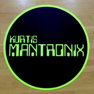 Kurtis Mantronix – Main Logo Inverted Fluorescent Yellow Slipmat